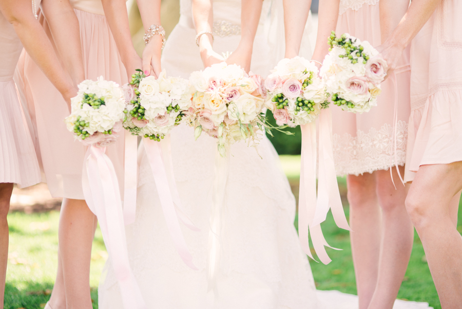 Photo of Bride and Bridesmaids with Bouquets