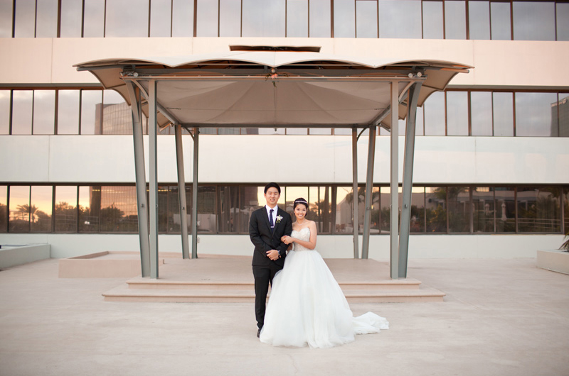 Bride and Groom Pose in Front of the Westin South Coast Plaza