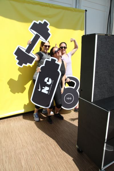 Event Guests Pose with Nike Props for the Video Booth
