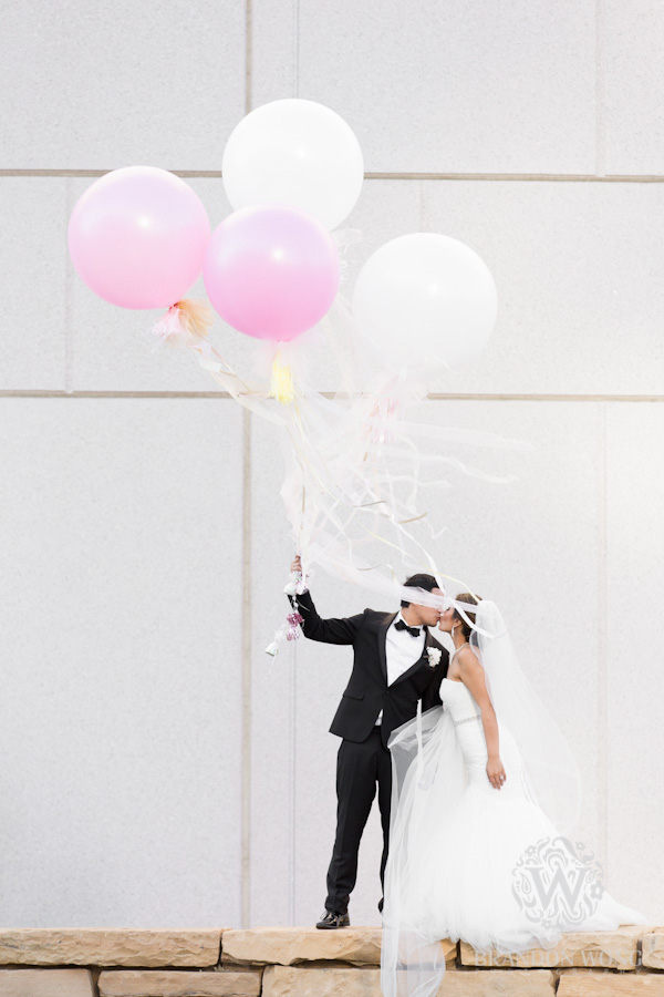 Newlyweds Pose with Balloons