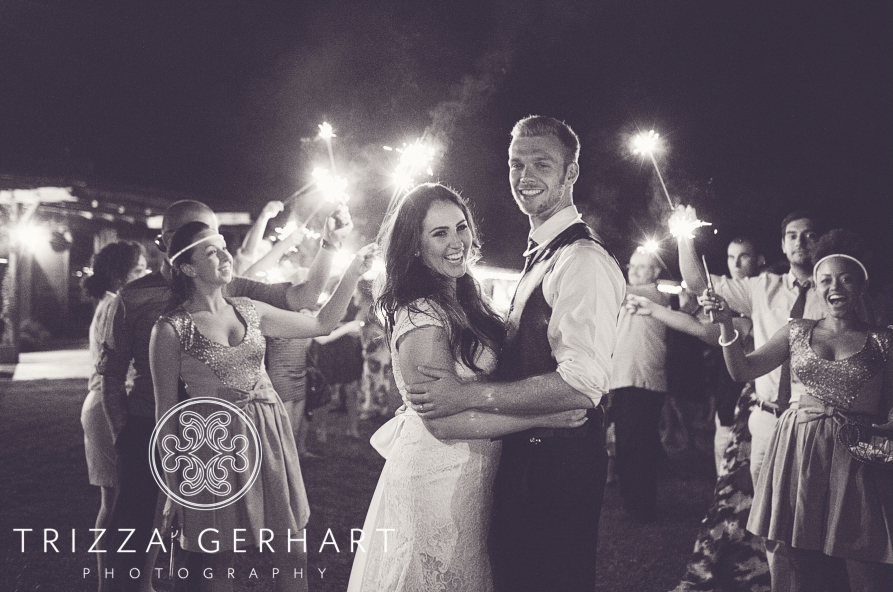 Guests Wave Sparklers for the Newlyweds