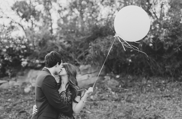 Black and White Photo of Couple with Balloons