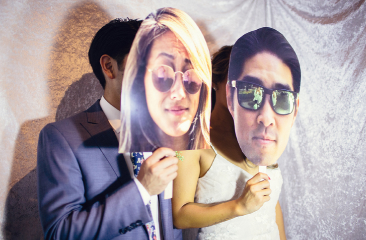 Guests Pose with Props in the Photo Booth