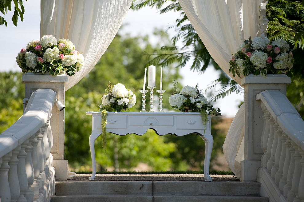 Vintage Pieces Pair with Florals for a White on White Ceremony Setting