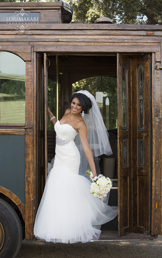The Bride Poses on an Old Trolley at the Viaggio Estate and Winery