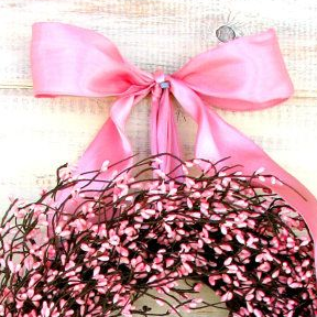 A Pink Accented Wreath Displayed for Breast Cancer Awareness Event