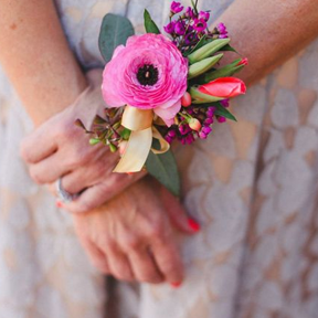 Mother of the Bride Wears a Floral Sash and Corsage
