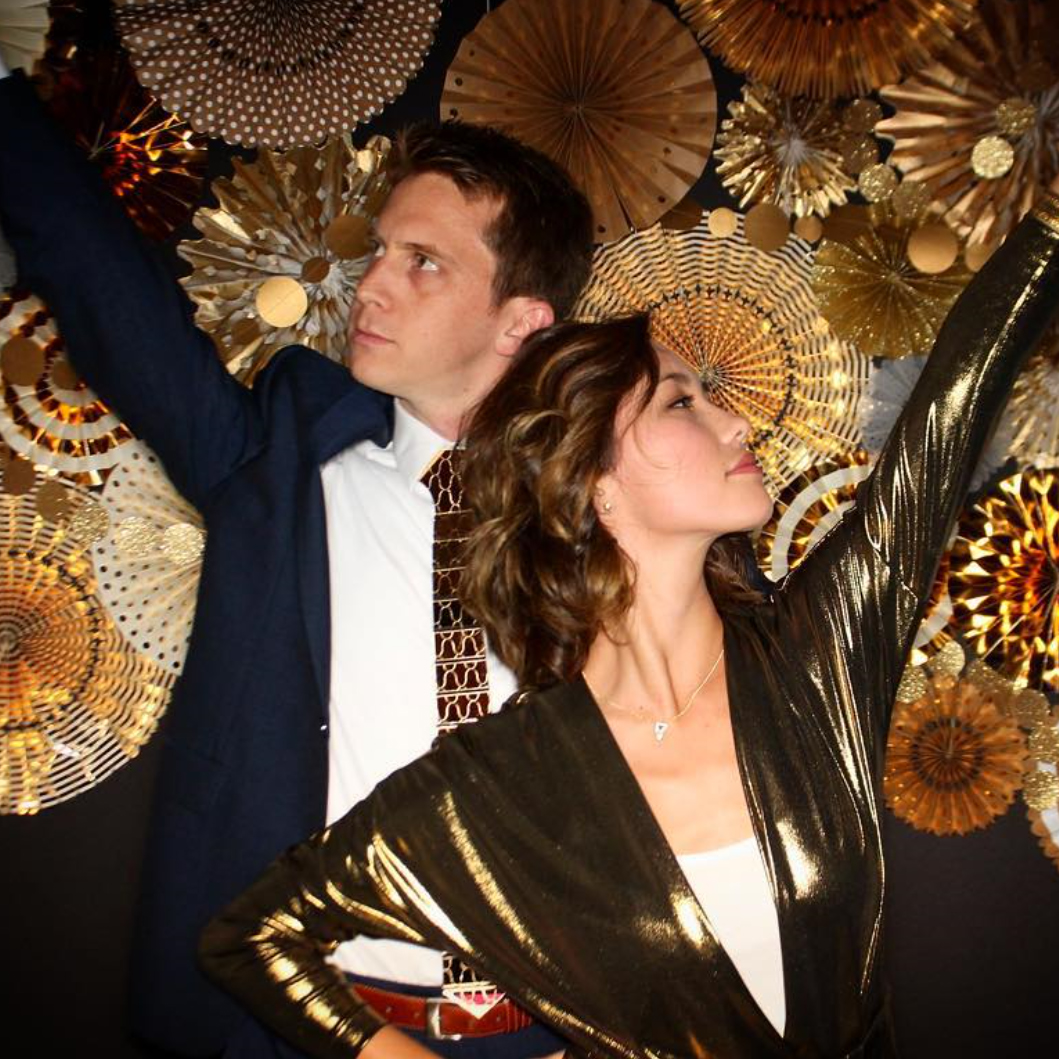 Guest Pose for the Photo Booth in Gold Disco Style