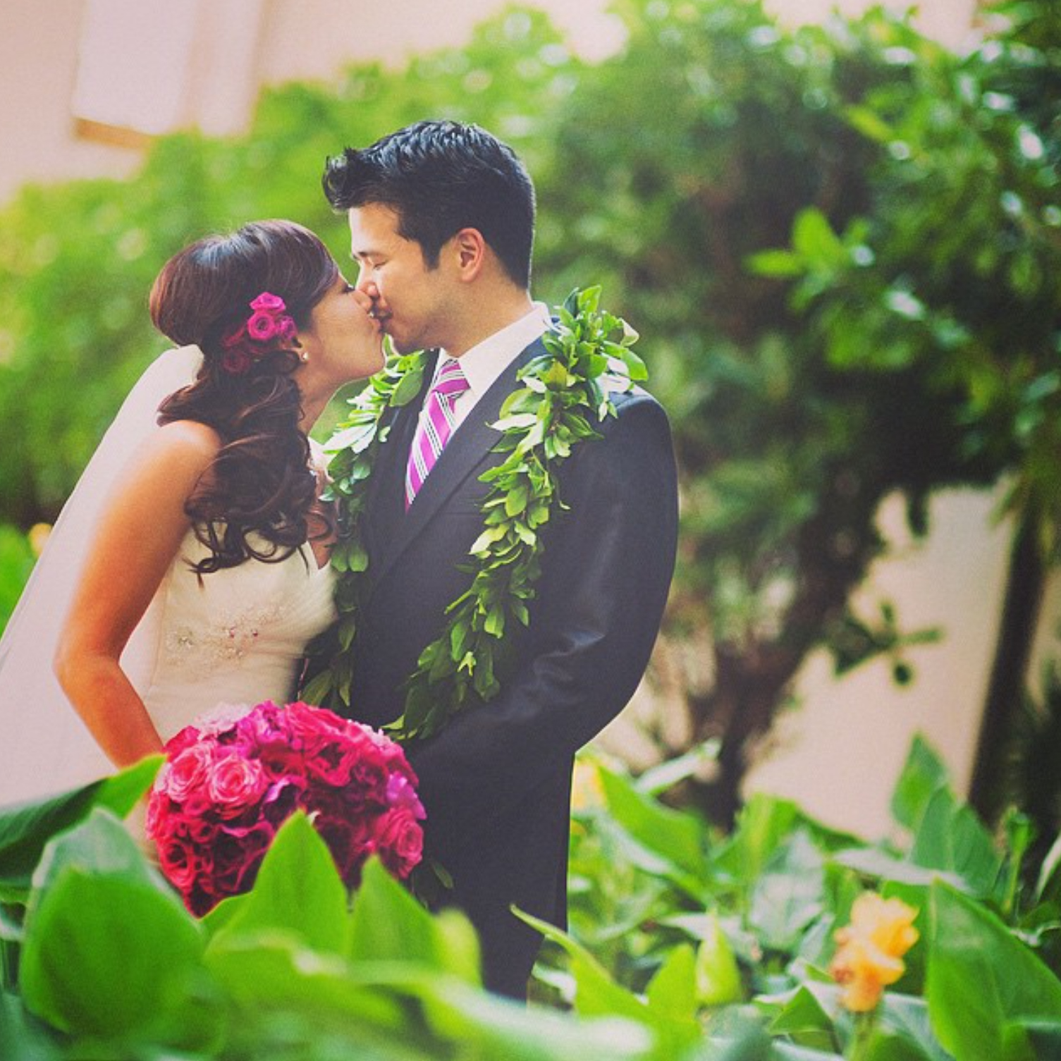 Bride Holds a Hot Pink Bouquet and Groom Wears a Maile