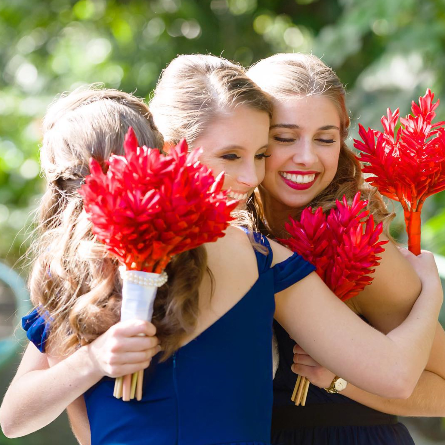 Blue Dresses and Red Bouquets Make a Colorful Party