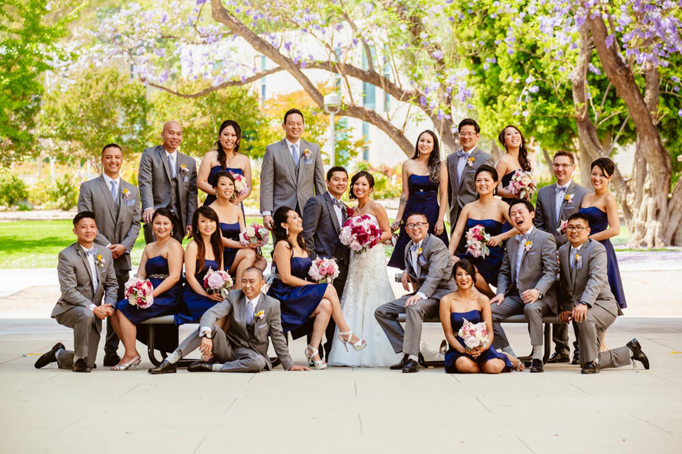 Bridesmaids and Groomsmen Pose with the Bride and Groom