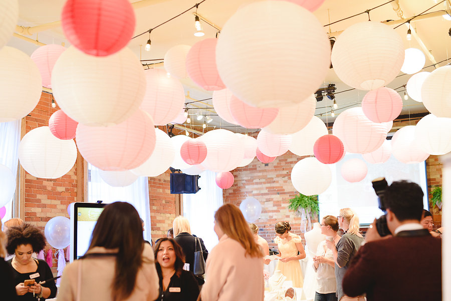 Lanterns in Shades of Pink Hang from the Ceiling